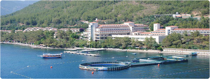 the open seawater pool arial with marmaris in background
