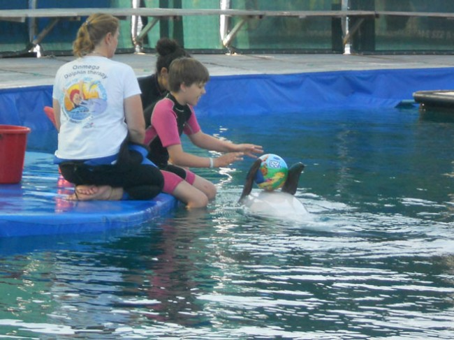 Sandra swims with Dolphin in Marmaris